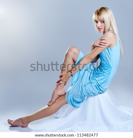 Curvy blonde girl  in a dress - stock photo