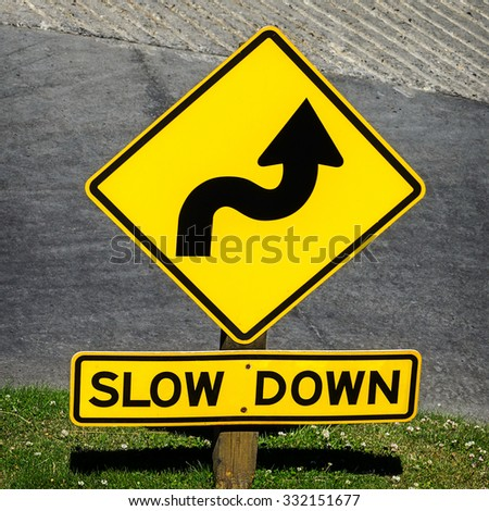 Curvy road sign on a  bend in the road - stock photo
