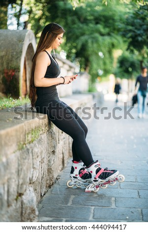 Curvy sexy young woman texting on the street - stock photo