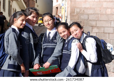 CUSCO PERU-NOV. 25:  Unidentified School girls posing for portrait on Nov. 25 2010 in Cusco Peru. One-third of girls in rural Peru never finish primary school. - stock photo
