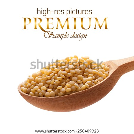 Cuscus in a wooden spoon / cereal on wooden spoons isolated on white background with place for your text  - stock photo