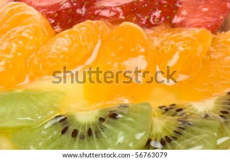 filled tart topped with summer fruits of Strawberry, mandarin orange ...