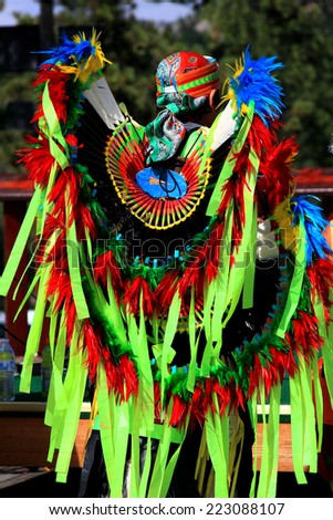 CUSTER, SOUTH DAKOTA - 8/31/14:  Back of young Lakota boy showing colorful tribal costume - stock photo