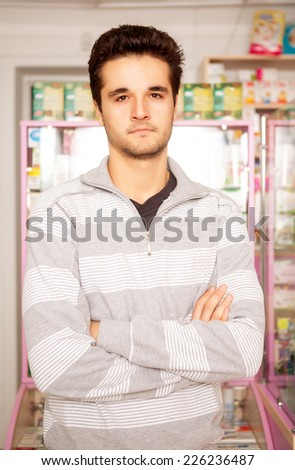 Customer in front of a pharmacy table shot with professional studio lighting. Care, expertise, drugs and pills in back of men - stock photo