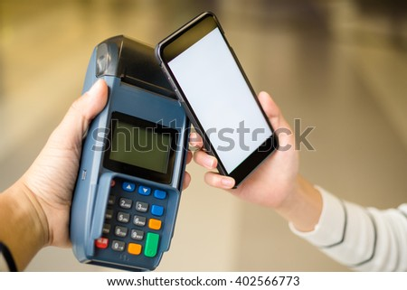Customer pay by smartphone with NFC - stock photo