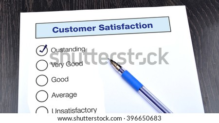 Customer Satisfaction Form with Outstanding checked - stock photo