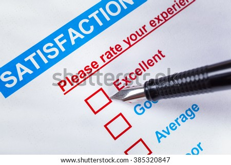 Customer satisfaction survey checkbox with rating and pen pointing at Excellent, can use any business concept background - stock photo