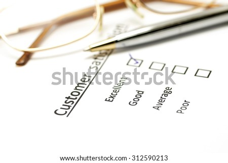 customer satisfaction survey form with the pen and eye glasses - stock photo