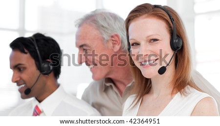 Customer service agents and their manager in a call center - stock photo