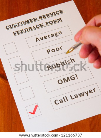 Customer Service Feedback Form with `Call Lawyers` checked on brown background - stock photo