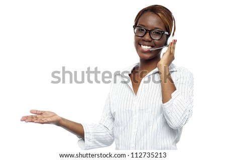 Customer service representative attending calls. Making gestures with hand while explaining it to client - stock photo