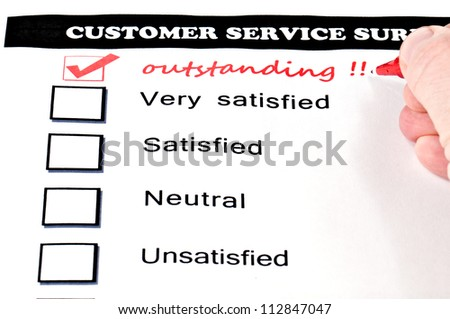 "Customer service survey form. extra checkbox drawn with handwritten word ""outstanding"". - stock photo"