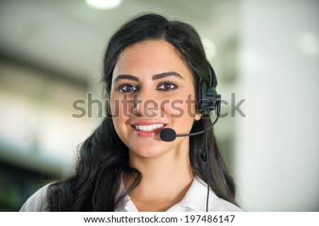 customer service worker, call center smiling operator with phone headset  - stock photo