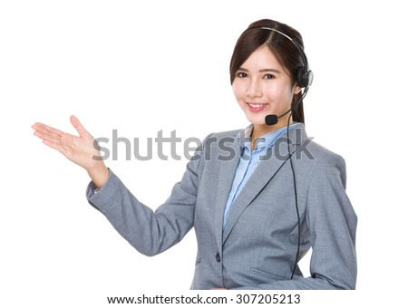 Customer services executive with hand showing blank sign - stock photo