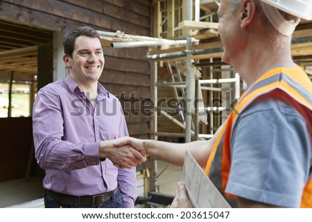 Customer Shaking Hands With Builder - stock photo