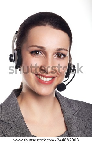 Customer support operator. Woman face.Call center smiling operator with phone headset on white background.Attractive young people working in a call center. - stock photo
