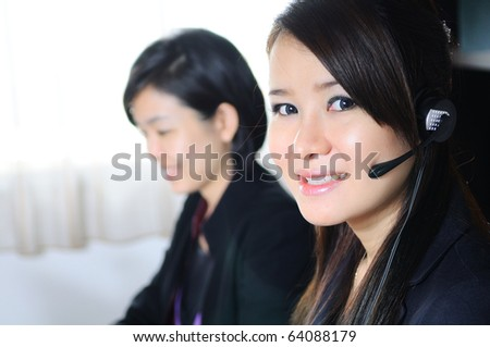 Customer support operator woman smiling at an office - stock photo