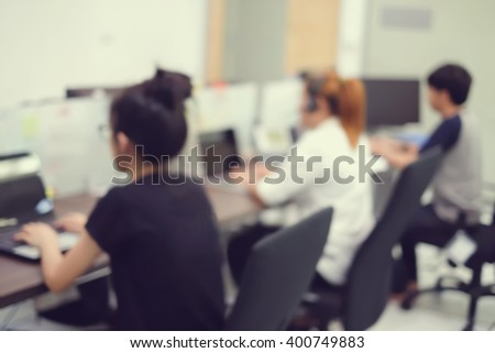 customer support service:blur officer working in headquarter center office room:staff training job career:blurry asian employee develop searching concept:worker learning studying satisfaction customer - stock photo