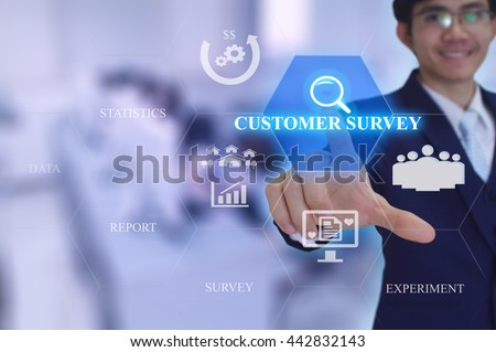 CUSTOMER SURVEY  concept  presented by  businessman touching on  virtual  screen - stock photo