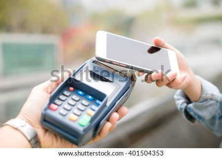 Customer using mobile phone for pay by the bill - stock photo
