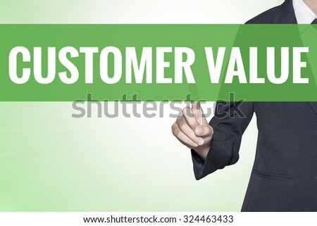 Customer Value word on green virtual screen touching by business woman - stock photo