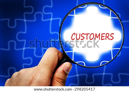 CUSTOMERS word. Magnifier and puzzles. - stock photo