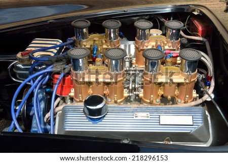 Customized car engine at show - stock photo
