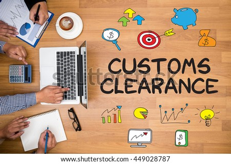 Customs Clearance Business team hands at work with financial reports and a laptop - stock photo