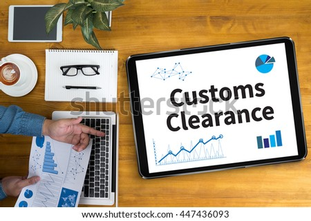 Customs Clearance Businessman working at office desk and using computer and objects, coffee, top view, - stock photo