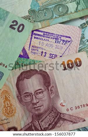 Customs stamp Airport Bangkok and Thai money - stock photo
