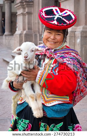 CUSZO, PERU - MARCH 18, 2015: Peruvian woman in traditional dresses pose  for tourists in Cuzco, Peru - stock photo