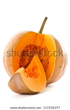 Cut a piece of ripe pumpkin on a white background - stock photo