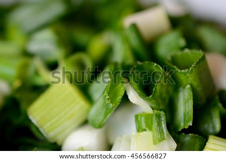Cut chives pieces closeup. Shallow depth of field. - stock photo