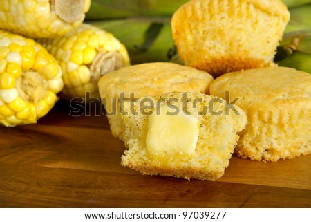 cut corn muffin with a pat of butter and ingredients - stock photo