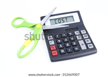 Cut cost concepts with calculator and scissors  - stock photo