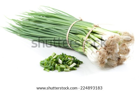 Cut green onion isolated on the white background - stock photo