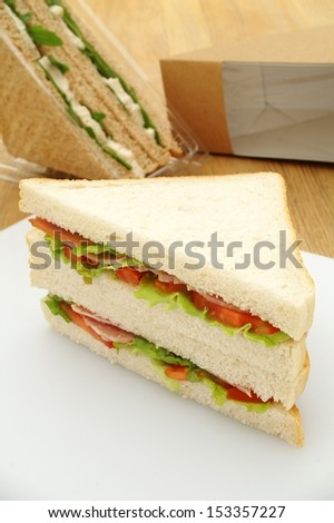 cut ham sandwiches with packaging - stock photo