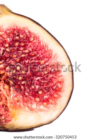 Cut in half fresh figs closeup on white background - stock photo