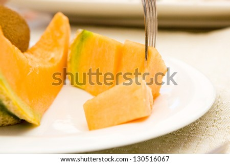 Cut melon on the plate - stock photo