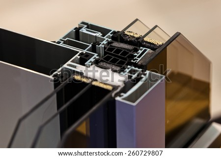 Cut of the window profile with metal, glass and insulation - stock photo