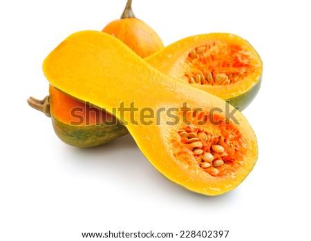 Cut orange Pumpkin on white background - stock photo