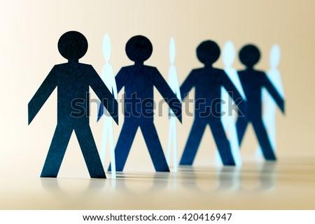 Cut out of paper people in chain - stock photo