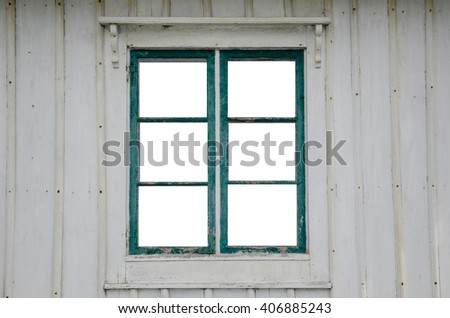 Cut out windowpanes in an old weathered window at a wooden plank facade - stock photo