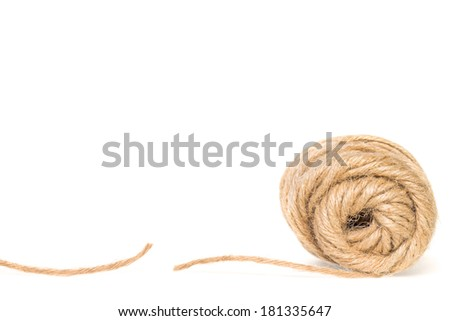 Cut piece of rough texture twine string. Unrolled coil end view. Isolated. Room for text, copy space. Horizontal photo.  - stock photo