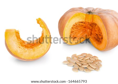 Cut pieces of pumpkin soup and slices and seeds.  On a white background. - stock photo