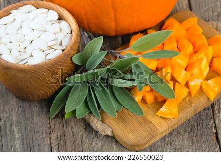 cut pumpkin on wooden background - stock photo