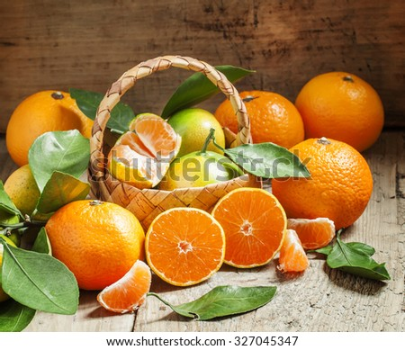 Cut ripe juicy orange tangerines, selective focus - stock photo