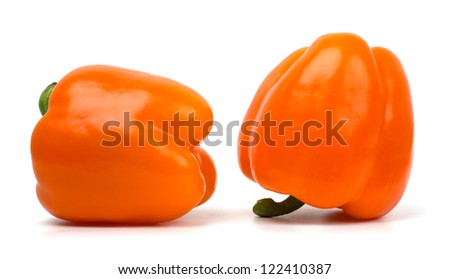 Cut sweet red peppers isolated on white - stock photo