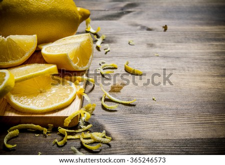 Cut the lemon zest on the Board. On a wooden table. Free space for text . - stock photo