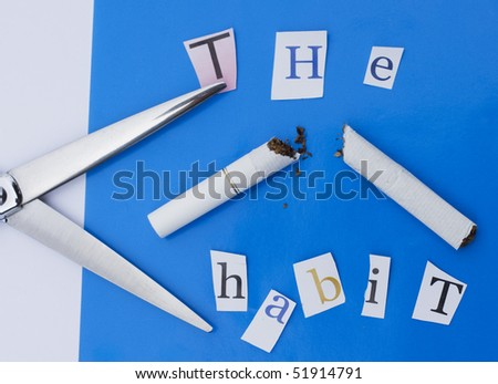 Cut the smoking habit.  A pair of scissors, a broken cigarette and some letters from a magazine. - stock photo